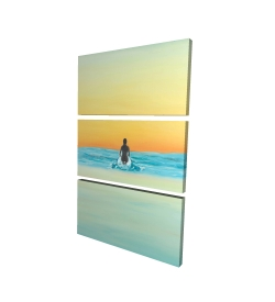 A surfer swimming by dawn