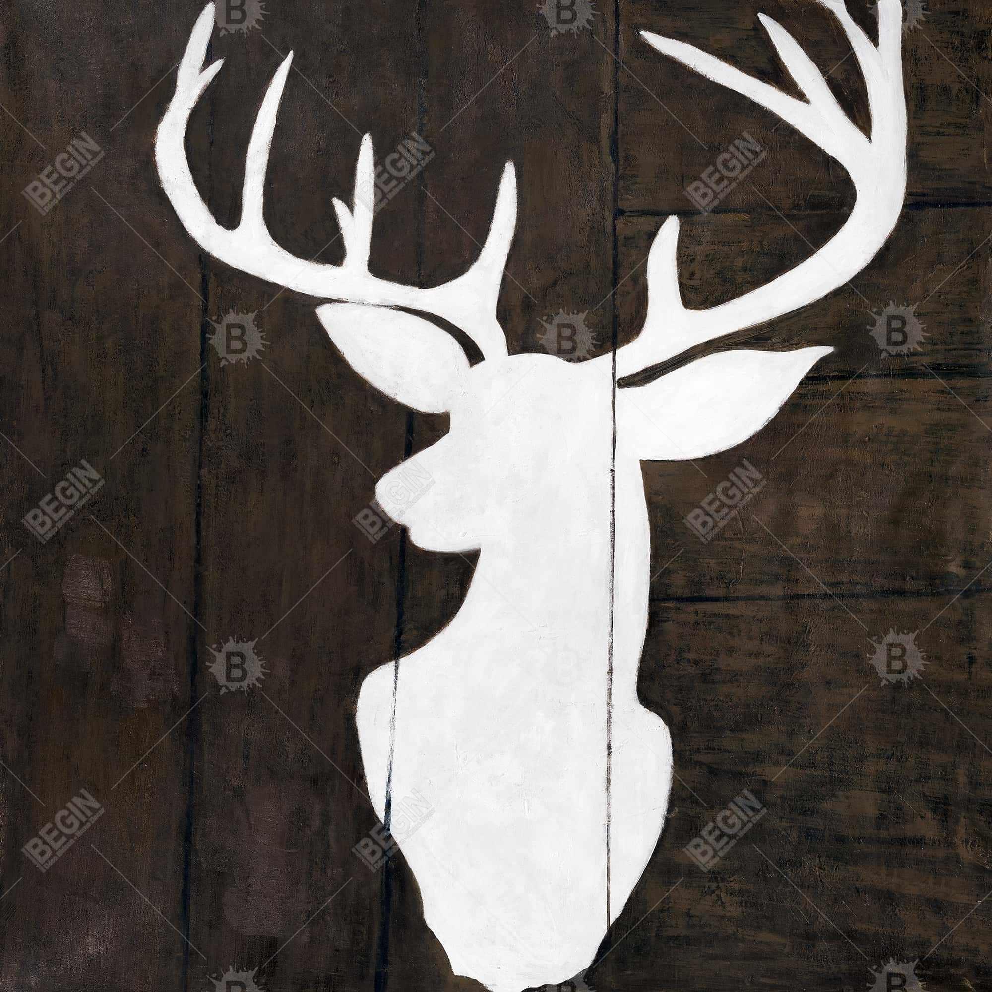 Silhouette of a deer on wood