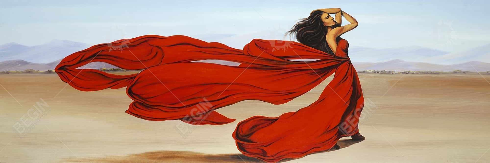 Woman with a long red dress in the desert