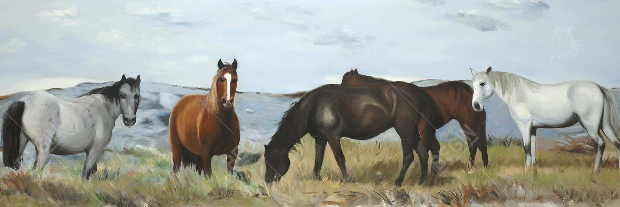 Horses eating in the meadow